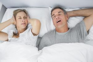 Man snoring next to partner