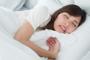 woman stressed sleeping
