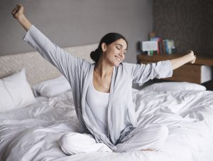 Woman waking feeling rested