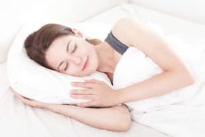 woman sleeping peacefully and smiling